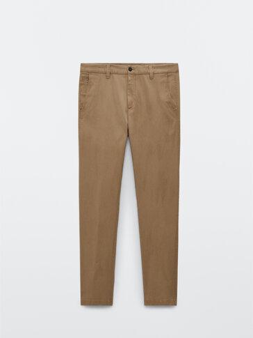 Bawełniane spodnie chinosy tapered fit