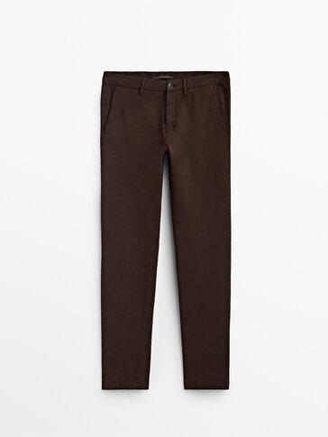 Spodnie chinosy z trykotynowej bawełny o kroju slim