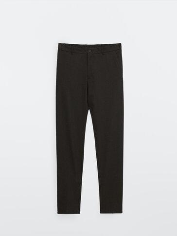 Black slim fit wool textured trousers