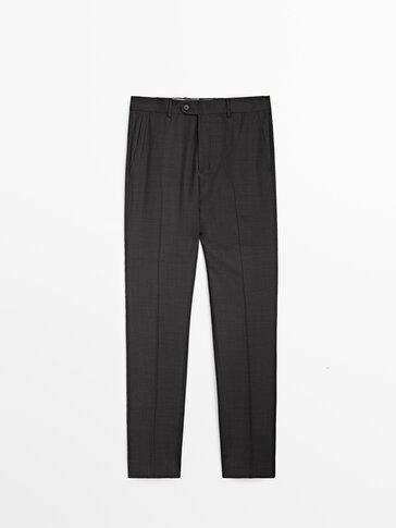 Szare spodnie od garnituru z melanżowej wełny