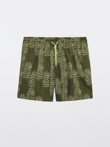 Palm leaf print swimming trunks