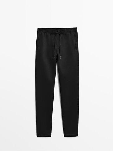 Dwustronnie wykończone spodnie casual fit