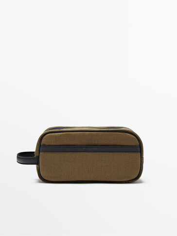 Contrasting toiletry bag with leather details