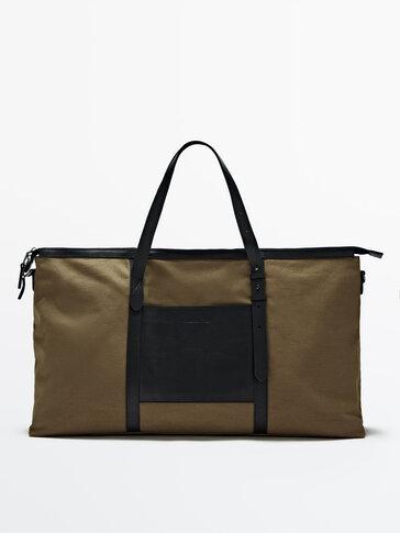 حقيبة من الكانفاس بتفاصيل جلدية