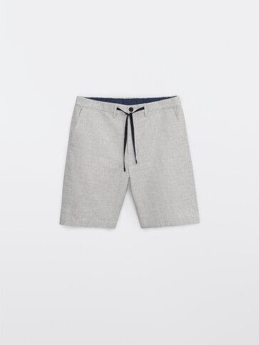 Striped cotton and linen Bermuda shorts
