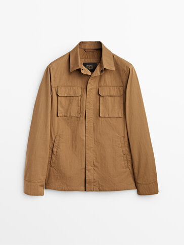 Safari jacket with leather detail