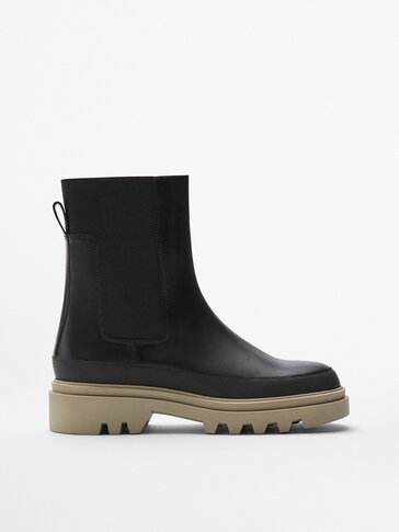 Black leather track sole Chelsea boots