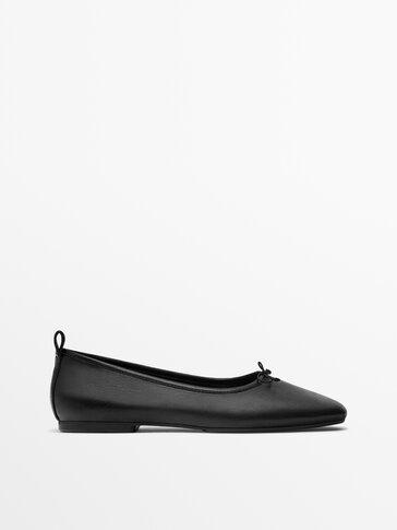 Black soft leather ballet flats