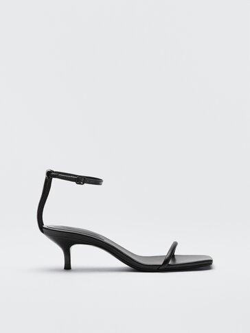 Melnas ādas sandales ar smailu papēdi