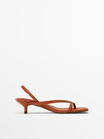 Orange asymmetric strap heeled sandals