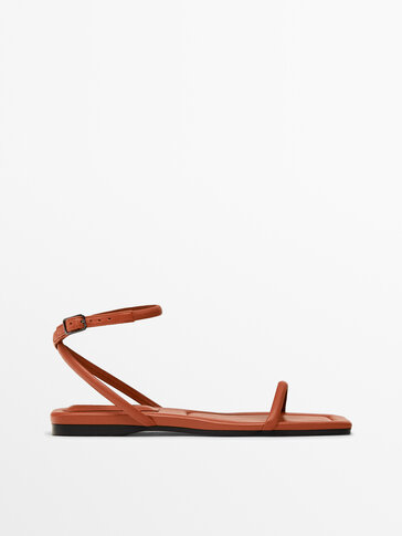 FLAT ORANGE LEATHER SANDALS WITH CROSSOVER STRAPS