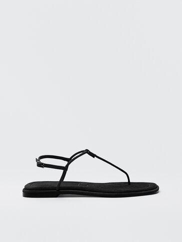 Черные босоножки на плоской подошве с ремешками