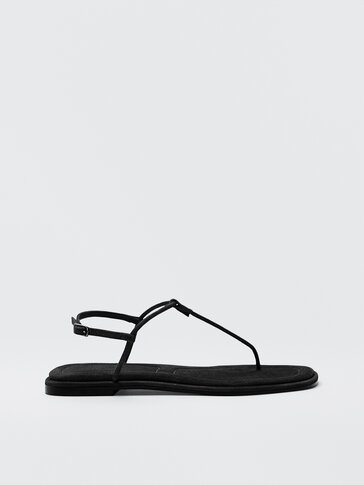Flat black strappy sandals