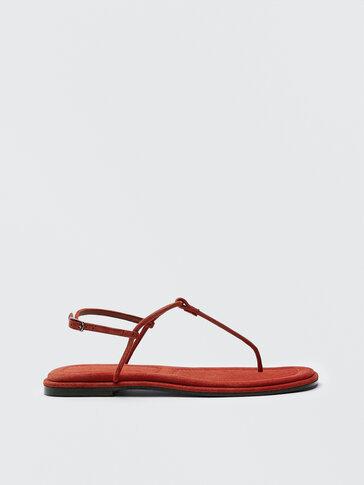 Flat orange strappy sandals