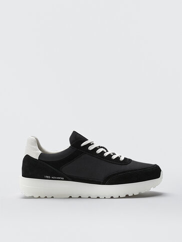 Contrasting black soft trainers