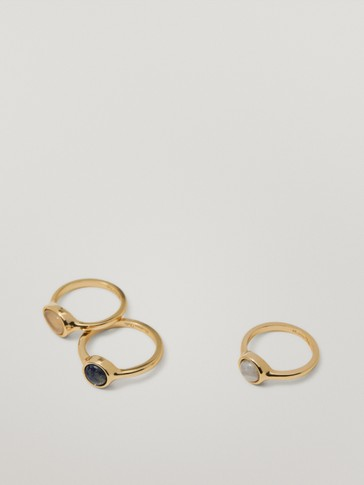 Set of gold-plated rings with stones