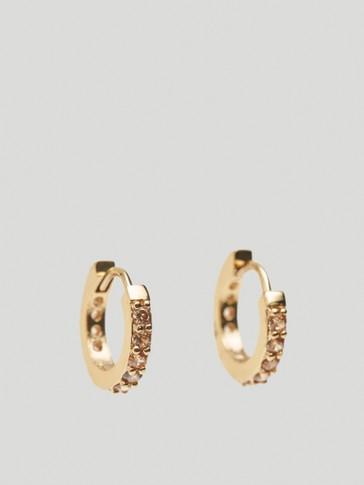 Gold-plated rhinestone-encrusted hoop earrings
