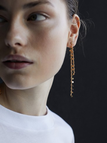 Long gold-plated charms earrings