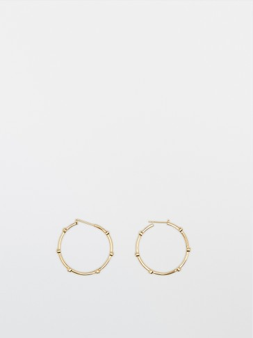 Gold-plated hoop earrings with sparkles