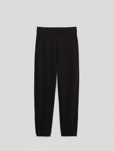 Jogger fit trousers with buttons at the hem