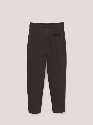 Trousers with side buttons