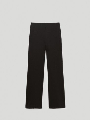 Black kick flare trousers