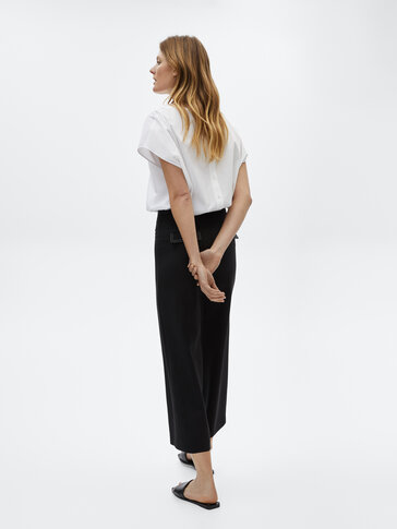 Black trousers with contrast topstitching