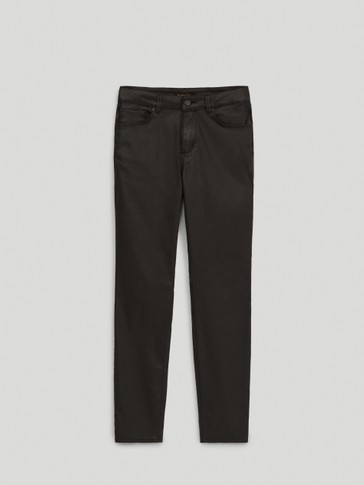 MID-WAIST RUBBERISED SKINNY FIT TROUSERS