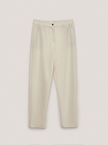 Jogging trousers with buttoned waist