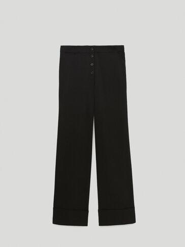 Широкие брюки с отворотами