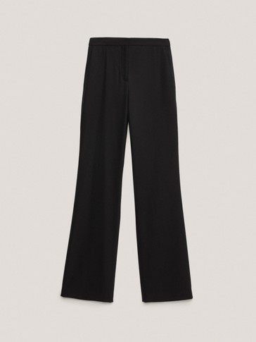 Flared black wool trousers