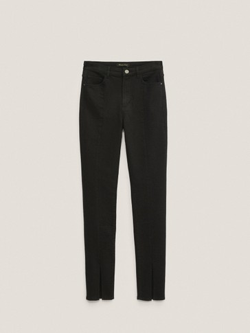 Black skinny jeans with slits