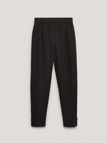 Straight trousers with buttoned hems