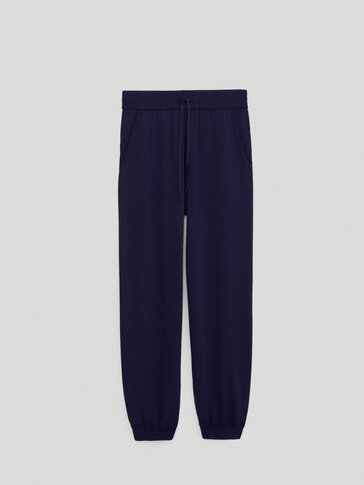 Knit trousers with an elastic hems