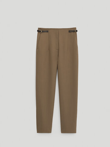 Darted trousers with side buckles