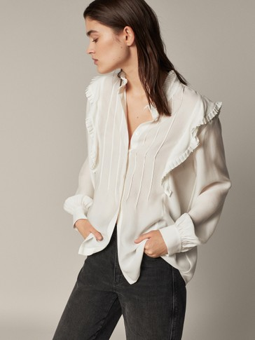 Shirt with pleated detail