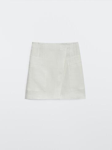 Falda corta 100% lino con bolsillos