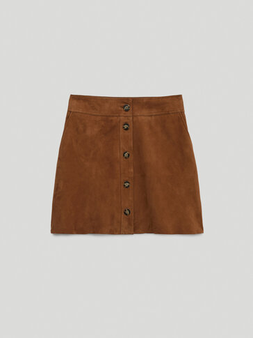 Buttoned suede mini skirt