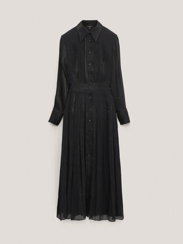 قميص طويل على شكل فستان لامع