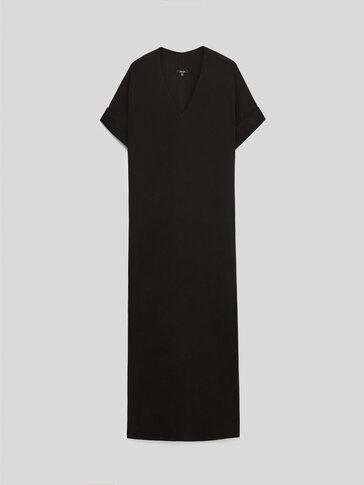 Black dress featuring side slits