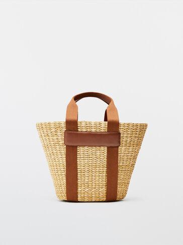 Tas keranjang dengan detail kulit
