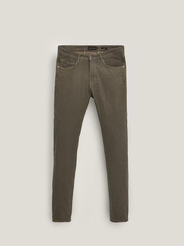 Slim-fit textured denim-effect trousers