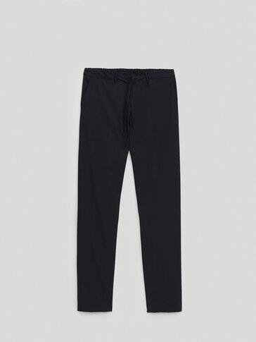 Μάλλινο παντελόνι με μικροσκοπικό πιε ντε πουλ
