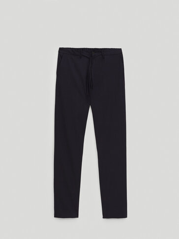 Micro-houndstooth wool trousers
