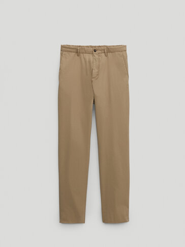 Slim-fit trousers with an elastic waist