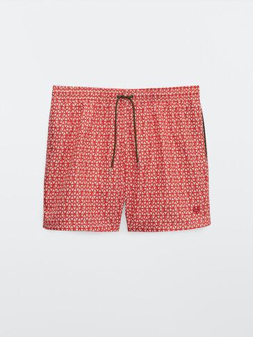 Triangle print swimming trunks