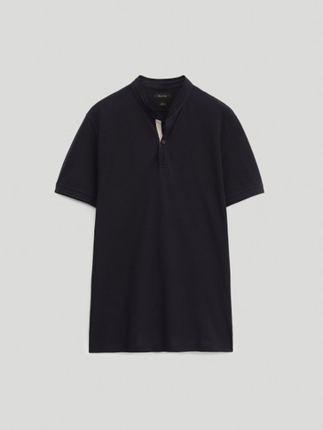 Kaus polo lengan pendek katun dengan kerah tegak