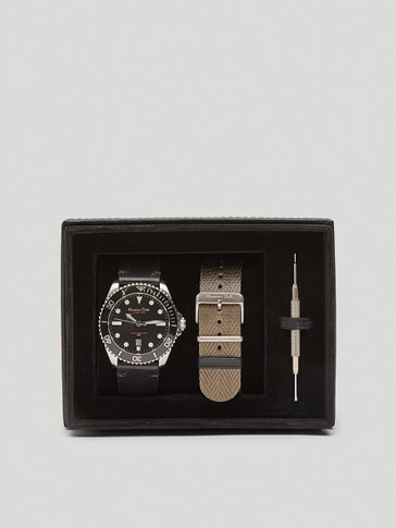 Watch with black face and interchangeable straps