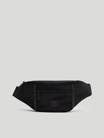 Black belt bag with leather details