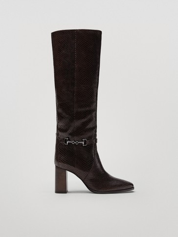 Animal print leather heeled boots with brown buckle detail